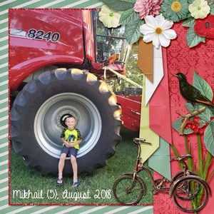 Mikhail on wheel of tractor